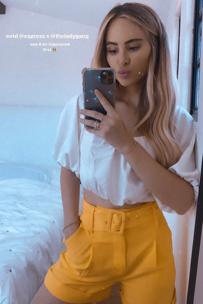 Amanda Stanton's Summery Yellow Belted Shorts - July 29, 2020