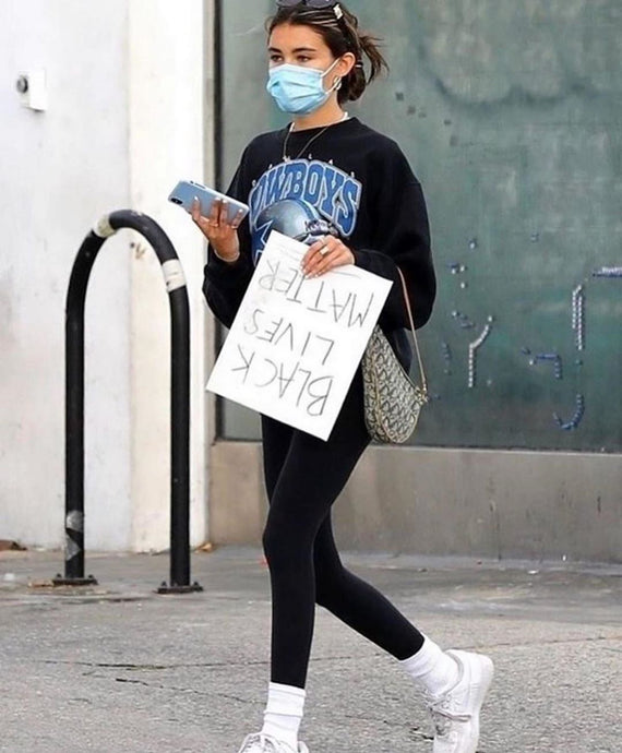 Madison Beer's Black Graphic Sweatshirt While Protesting