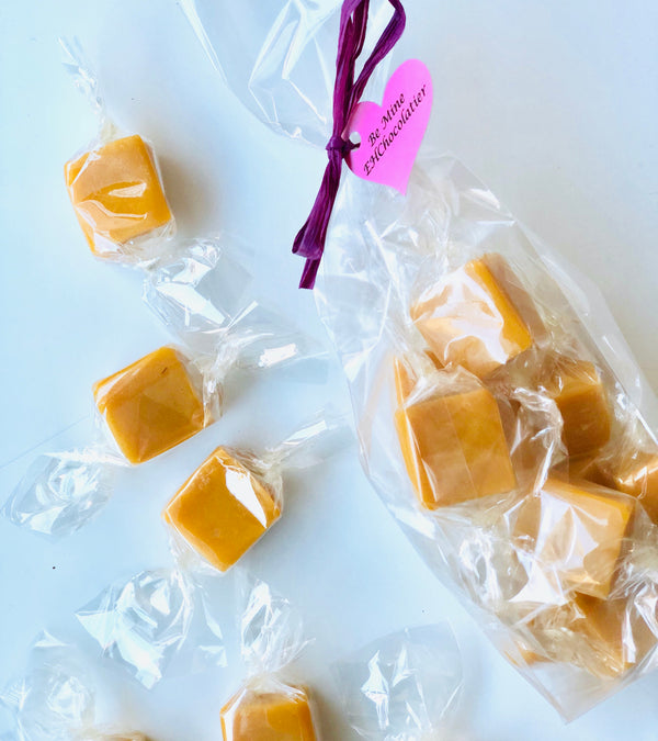 Passionfruit caramel in clear bag with ribbon and heart tag