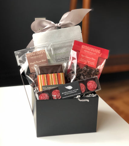 Vegan Luxury Gift Box contains:  Dark Chocolate hazelnut bark, dark chocolate tasting bars, Meltaways, Tart Cherry bites, Maple Pecan bites.