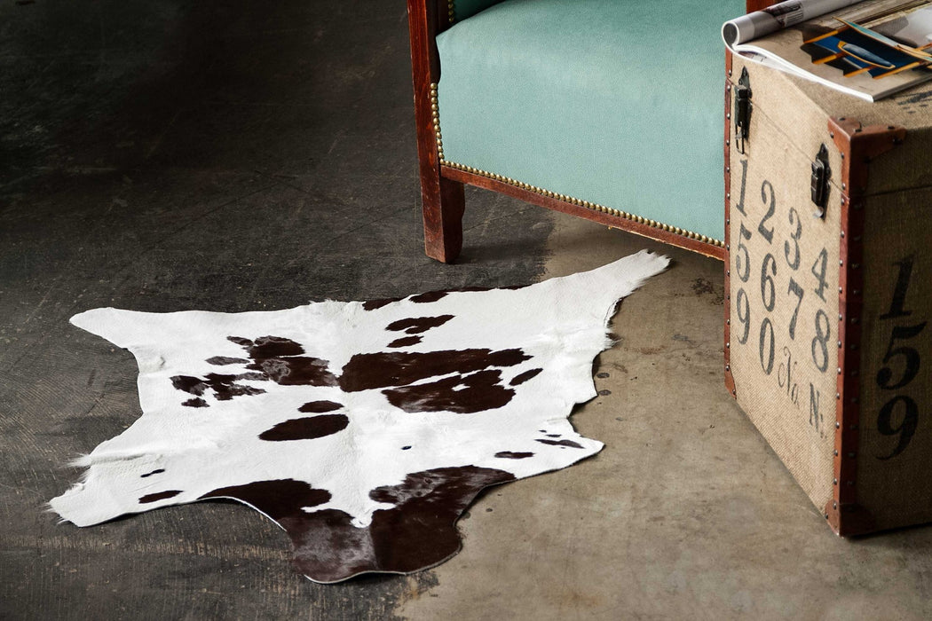 "HomeRoots 24"" x 36"" Chocolate And White Calfskin - Area Rug"