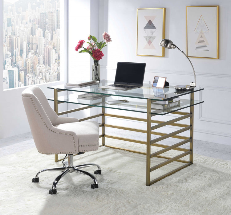 "HomeRoots Office 28"" X 56"" X 31"" Antique Gold Clear Glass Metal Desk"