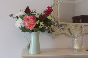 Finest Faux flowers available in Ireland displayed in a country style jug with peonies and artificial foliage