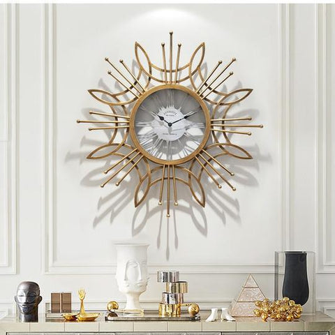 Large Golden Metal Circular Quartz Wall Clock With Needle Display, Abstract Pattern, Has 30mm Thick Plate, Single Face Form, Of Size 79.5x79.5x3.5cm/31.3x31.3x1.4inch Is Powered By: AA 1.5V Battery, available exclusively on Shahi Sajawat India,the world of home decor products.Best trendy home decor, living room and kitchen decor ideas of 2019.