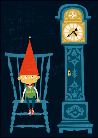 Little boy wearing a tall red elf hat sits in a blue chair next to a blue grandfather clock waiting for Santa Claus.