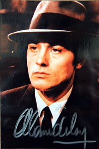 Original color photograph signed by Alain Delon.