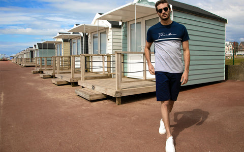 Man wearing a Threadbare t-shirt and shorts ready for Spring