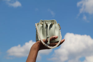 """Growth"" mint green small bucket bag with pearl chain and crossbody chain"