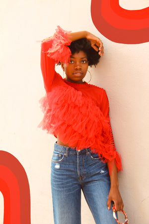 Red fringed long sleeve crop top.