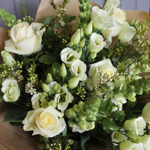 All white bouquet - no lilies.