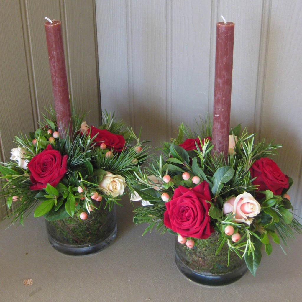 Christmas table centers in glass tank vases.