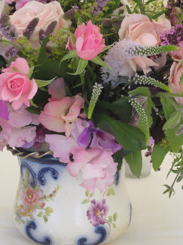 Vintage jug and cottage garden style flowers.