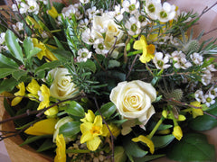 Spring posy in cream and yellow.
