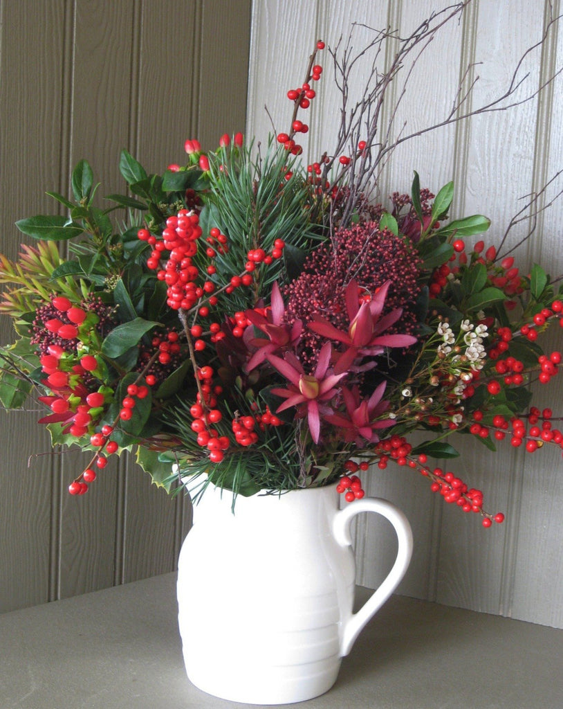 Christmas foliage and berry bouquet in Burleigh cream ware jug