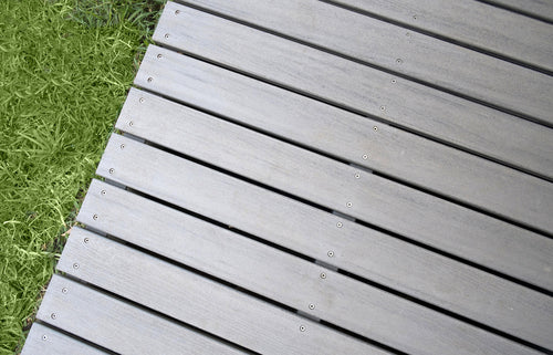 Refinishing Decks on an Industrial Level close up of composite deck