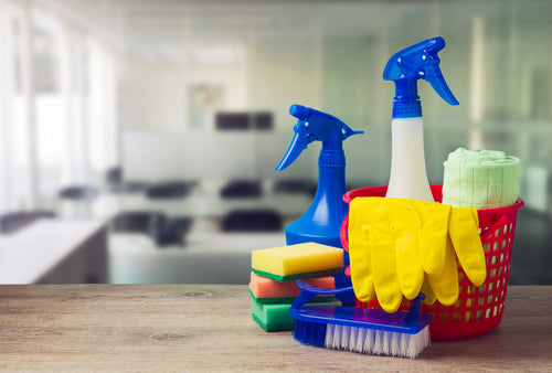 Spring Cleaning Checklist For Your Commercial Building office cleaning concept pile of cleaning supplies