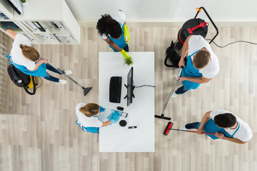 Spring Cleaning Checklist For Your Commercial Building staff cleaning office floors