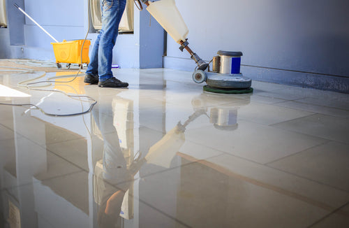 When And How To Buff Your Commercial Floors worker buffing commercial floor