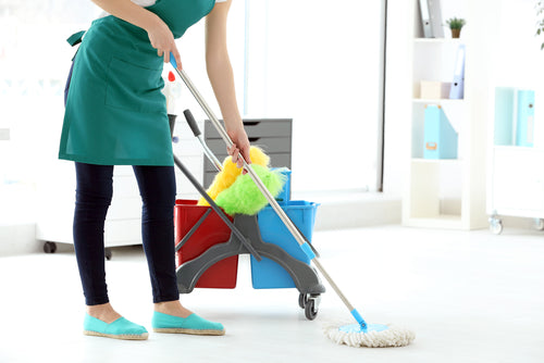 How To Choose From 7 Key Types Of Tile For Your Business woman cleaning floor in office