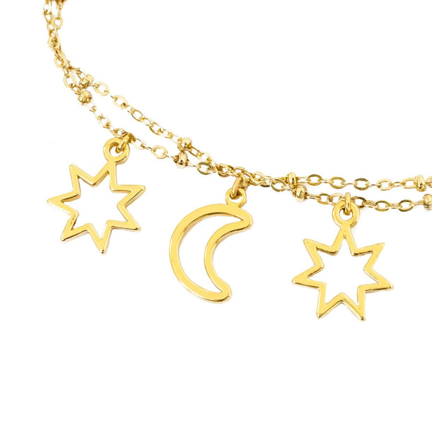 close up of sun and moon bracelet in gold tone