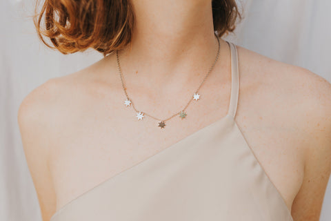 Girl wearing short Constellation Necklace with silver stars