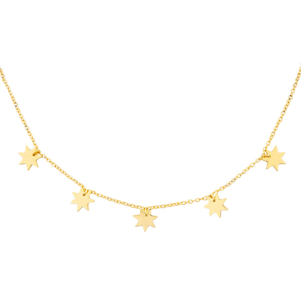 Close up of Constellation Necklace featuring gold stars