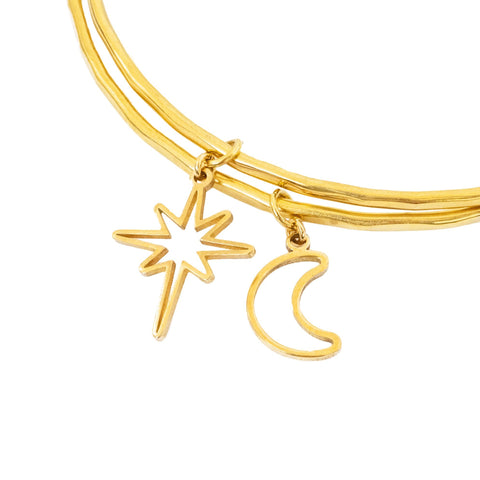 Close Up of Star and Moon Charms on Brass moonlight bangles