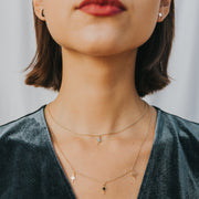 model wearing layered gold star necklace - starry night necklace