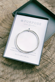 Ethically Handcrafted Rhodium Bangle Bracelets that give back to non-profit, International Sanctuary