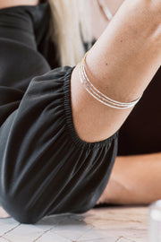 Ethically Handcrafted Rhodium Bangle Bracelets that give back to non-profit