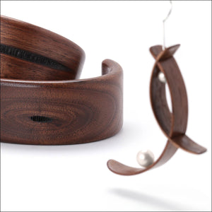 Walnut wood cuffs and earrings.