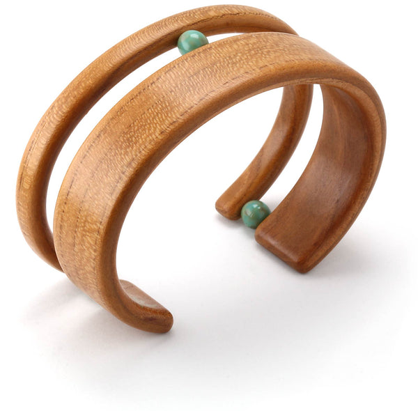 Steam bent wide apricot wood cuff bracelet with 3 Swarovski crystal pearls.