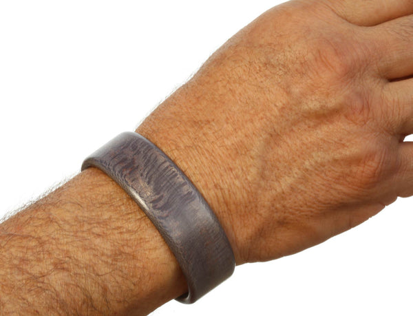 Steam bent grey sycamore wood wide cuff bracelet on model.