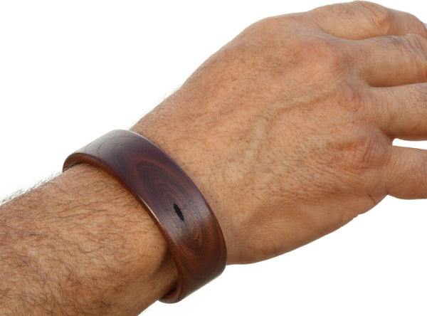 Steam bent walnut pith wood wide cuff bracelet on model.