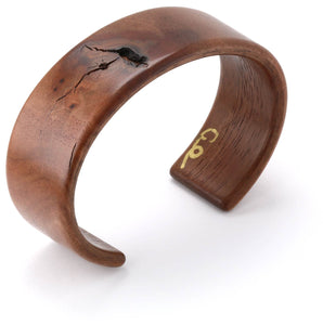 Steam bent walnut knothole wood wide cuff bracelet.