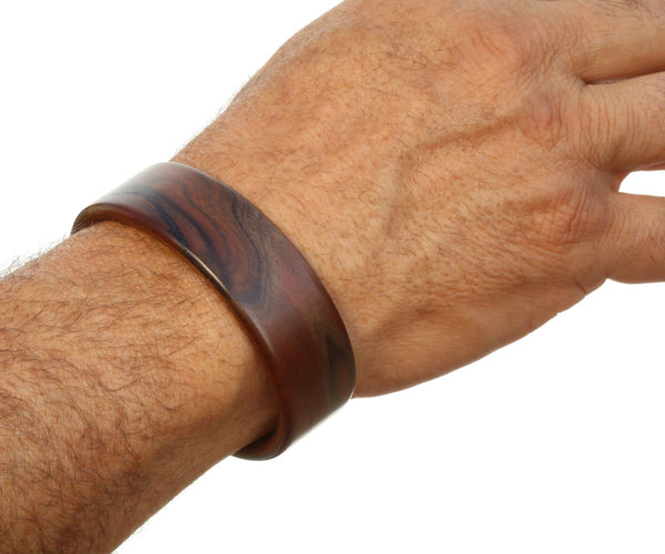 Steam bent walnut burl wood wide cuff bracelet on model.