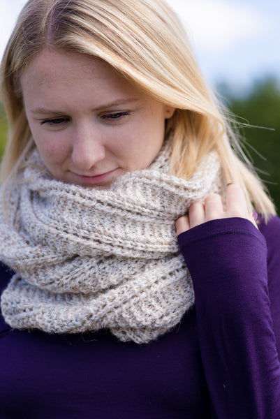 scarf wrapped cozy on young woman