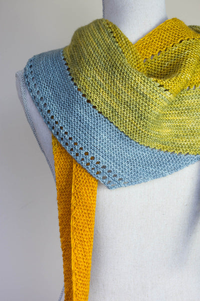 SIdeways triangle scarf with eyelets on a Manniquin