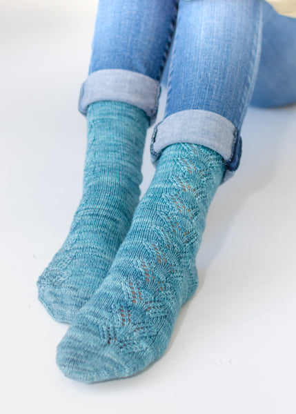 Close up of Handknit socks with Lace