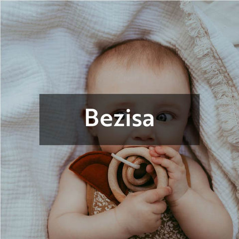 Baby biting on Bezisa wooden teether