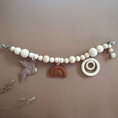 Wooden beaded pram chain with a double wooden ring, felt orange sunset and dark light brown felt bird on a brown background
