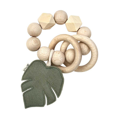 Wooden beaded Bezisa rattle with two wooden rings and a felt monstera leaf in pistachio green