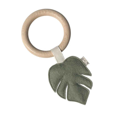 Felt monstera leaf in pistachio green on a wooden teething ring