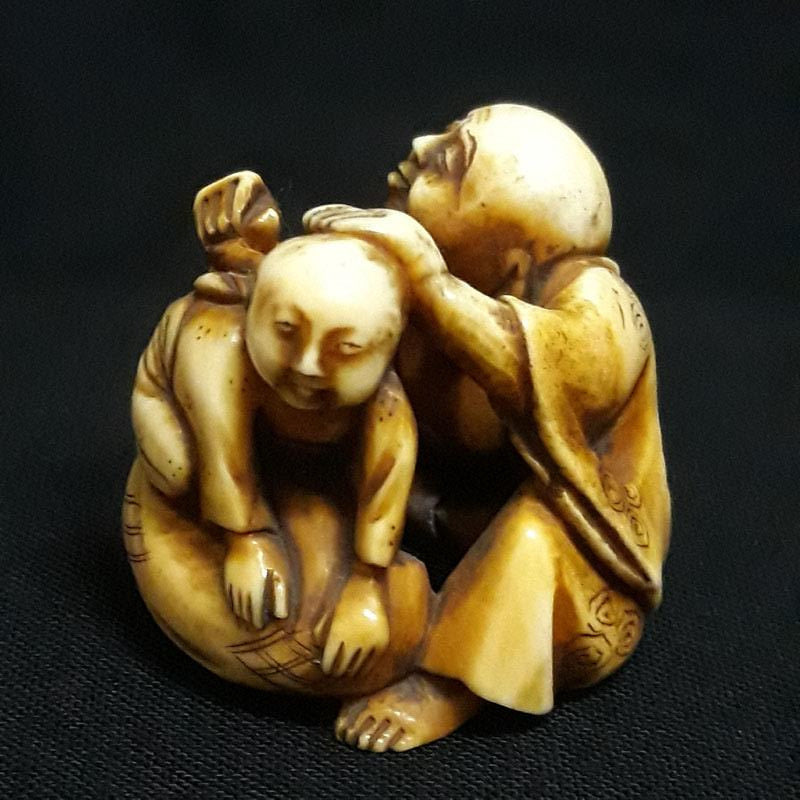 Hotei with Child Antique Netsuke Late 19th century Meiji Era