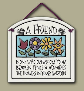 """A friend is one who overlooks your broken fence & admires in your garden"" Stoneware Plaque"