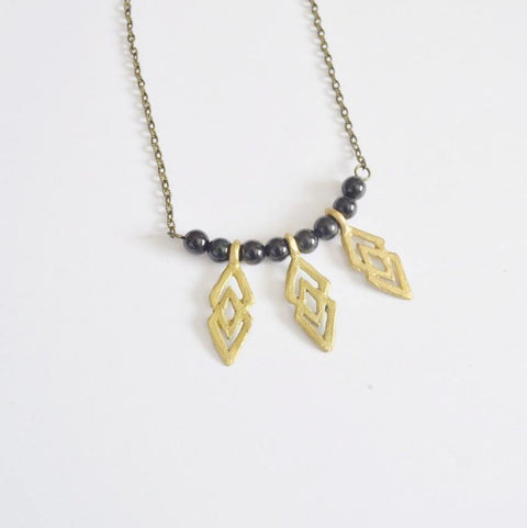 Justice & Equality | Mini Adrinkra EPA Symbol Black and Gold Statement Necklace - Alora Boutique - Jewelry with meaning that gives back fashion for good