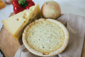 Eggcellent Quiche -Carmelized Onion and Herbed Goat Cheese