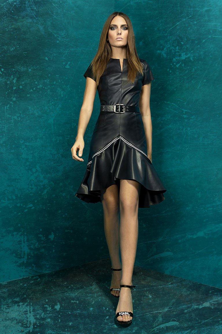 FAUX LEATHER ASSYMETRIC DRESS WITH RUFFLE DECORATIVE FAUX LEATHER ASSYMETRIC DRESS WITH RUFFLE DECORATIVE