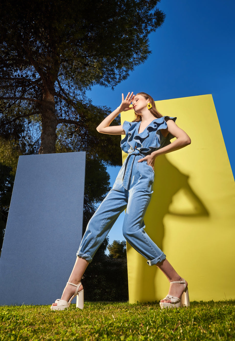 JEAN JUMPSUIT WITH DECORATIVE RUFFLE AND BELT