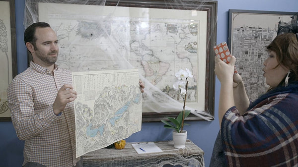 Sammy Berk of New World Cartographic holding a map that sold as a gift.